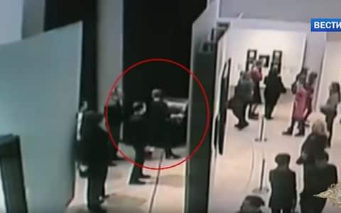 CCTV videos captured the moment when a man took the painting by Arkhip Kuindzhi off the wall at the Tretyakov Gallery and walked away casually, - Credit: Российское Мнение