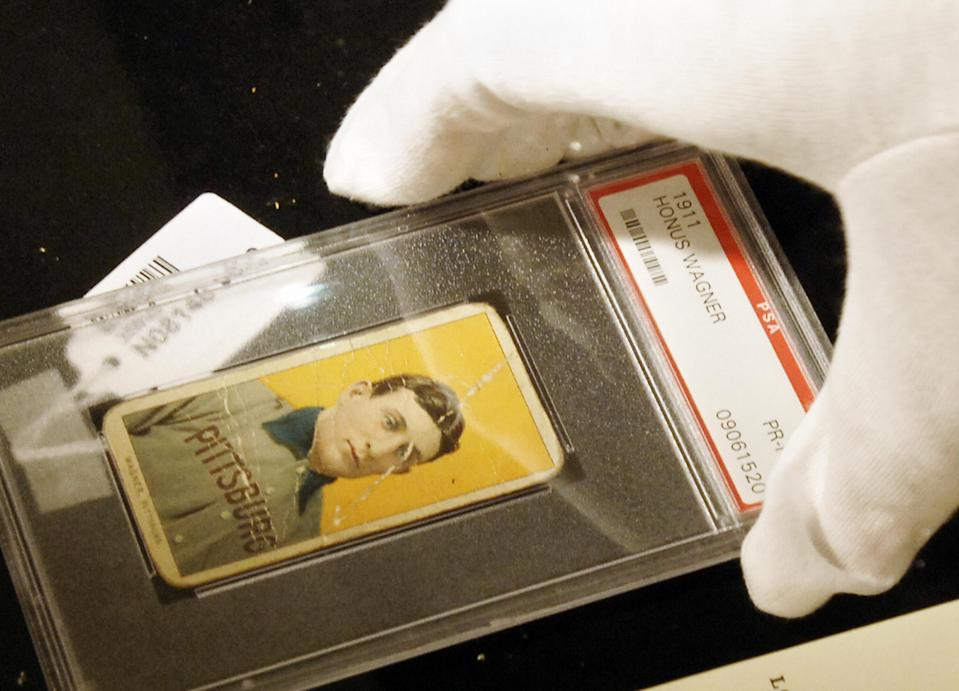 A rare Honus Wagner card has sold for $1.4 million, a record amount for a card in poor condition. (STAN HONDA/AFP/Getty Images)