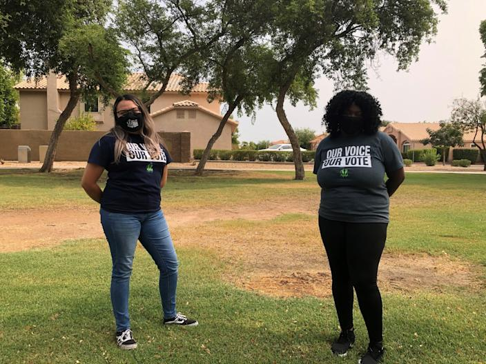 """Karen Hernandez, left, and Danaysha Smith, staff members for the progressive voter organization Our Voice, Our Vote, on Sept. 12 in Glendale, Arizona. <span class=""""copyright"""">(Melissa Gomez / Los Angeles Times)</span>"""