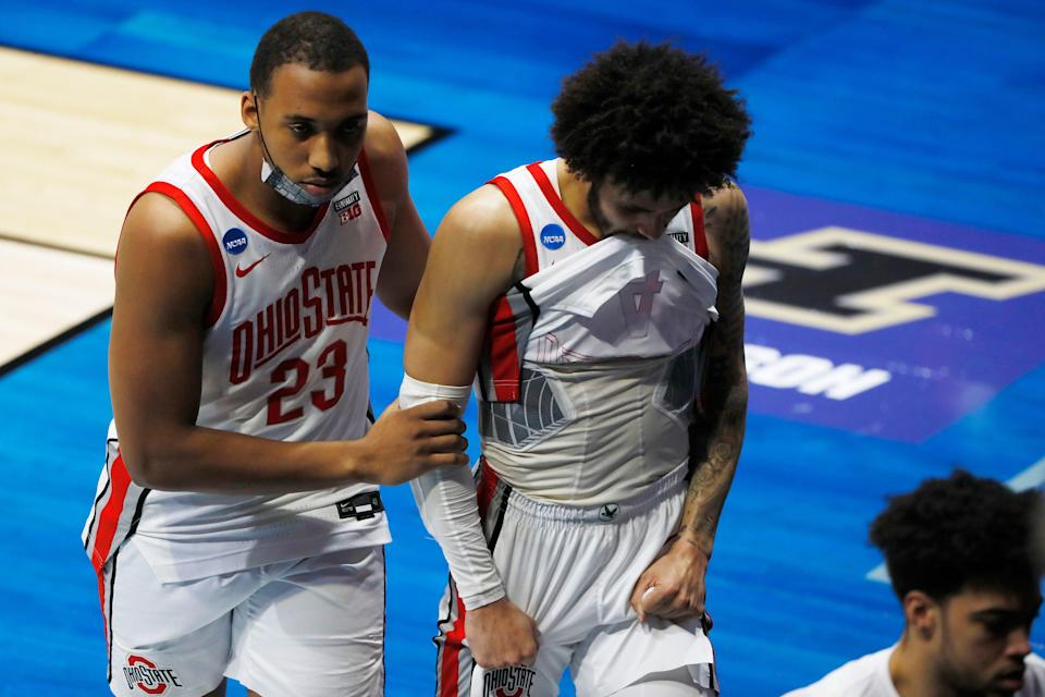 Zed Key and Duane Washington Jr. (right) leave the court after Ohio State lost to Oral Roberts in overtime.