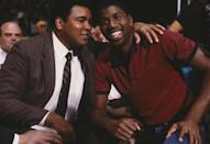 <p>Magic Johnson poses for the camera with Muhammad Ali. (Photo by Focus on Sport/Getty Images)</p>