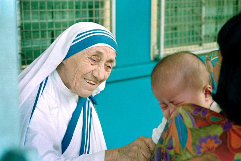 The debate over Mother Teresa's legacy has continued after her death, with researchers uncovering financial irregularities in the running of her order and evidence mounting of patient neglect (AFP Photo/Roslan Rahman)