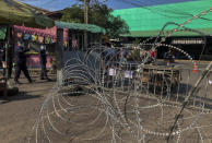 A shrimp market is closed and berbed-wired in Samut Sakhon, south of Bangkok, Thailand, Sunday, Dec. 20, 2020. Thailand reported more than 500 new coronavirus cases on Saturday, the highest daily tally in a country that had largely brought the pandemic under control. Health officials said the new cases are mostly migrant workers from Myanmar connected to the outbreak at the Klang Koong shrimp market in Samut Sakhon province. (AP Photo/ Jerry Harmer)
