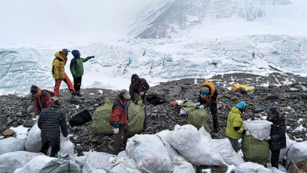 PHOTO: In this May 8, 2017, file photo released by Xinhua News Agency, people collect garbage at the north slope of the Mount Everest in southwest China's Tibet Autonomous Region. (Awang Zhaxi/Xinhua via AP)