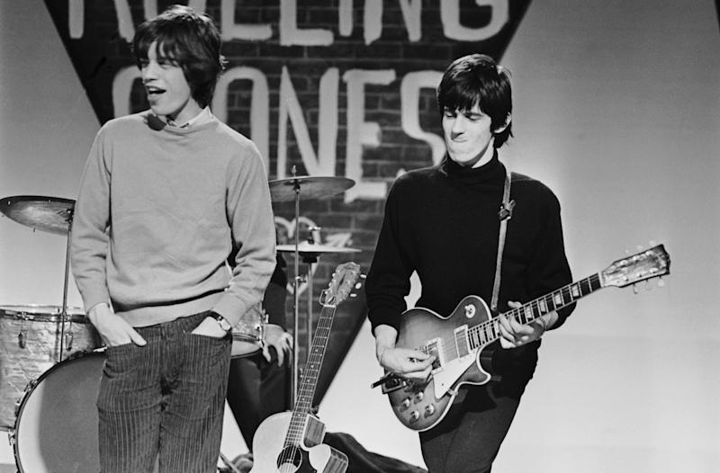 Mick Jagger and Keith Richards of the Rolling Stones prepare for a performance, circa 1965. (Photo by Terry O'Neill/Hulton Archive/Getty Images)