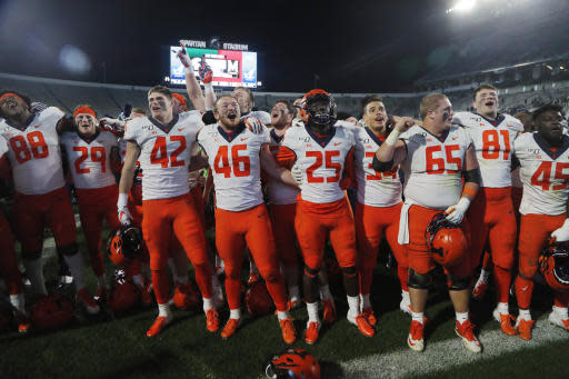 Members of the Illinois football team sing at the end of the team's NCAA college football game against Michigan State, Saturday, Nov. 9, 2019, in East Lansing, Mich. (AP Photo/Carlos Osorio)