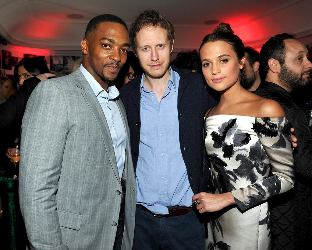 <p>Media recognition is also key to any Oscar campaign. Vikander, seen here with Anthony Mackie and a partygoer, was an honored guest at a <i>W Magazine</i> gathering just a few days before the Golden Globe Awards at Chateau Marmont on Jan. 7 in Los Angeles. </p><p><i>(Photo: Donato Sardella/Getty Images)</i></p>