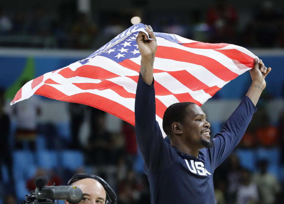 FILE - In this Aug. 21, 2016, file photo, United States' Kevin Durant celebrates after the team won gold in men's basketball at the Summer Olympics in Rio de Janeiro. Durant and coach Gregg Popovich will lead the U.S. team into the Tokyo Olympics as the Americans try to secure a fourth consecutive gold medal.(AP Photo/Matt York, File)