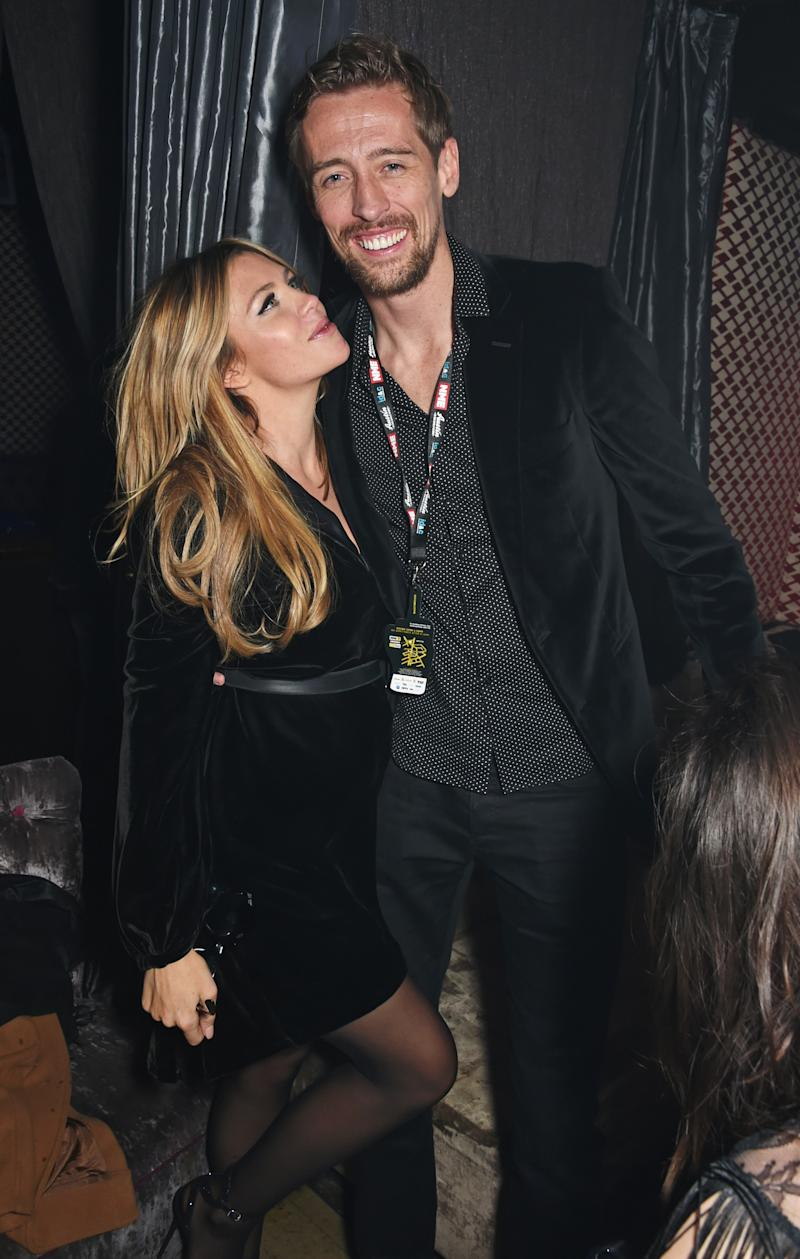 LONDON, ENGLAND - FEBRUARY 18: Abbey Clancy (L) and Peter Crouch attend the NME Awards after party at Cuckoo Club on February 18, 2015 in London, England. (Photo by David M. Benett/Getty Images)