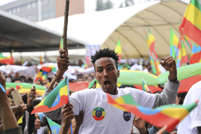 A man gestures as youth joining the Defense Forces gather, at Meskel Square, in Addis Ababa, Ethiopia, Tuesday, July 27 2021. A repatriation program is underway for young people from Ethiopia who have decided to join the Defense Forces. (AP Photo)