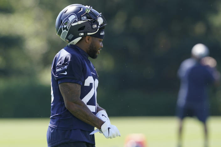Seattle Seahawks running back Rashaad Penny walks on the field after NFL football practice Thursday, July 29, 2021, in Renton, Wash. (AP Photo/Ted S. Warren)