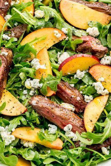 """<p>Peppery rocket is the perfect vessel for this savoury-sweet combo.</p><p>Get the <a href=""""http://www.delish.com/uk/cooking/recipes/a32998377/balsamic-grilled-steak-salad-with-peaches-recipe/"""" rel=""""nofollow noopener"""" target=""""_blank"""" data-ylk=""""slk:Balsamic Grilled Steak Salad with Peaches"""" class=""""link rapid-noclick-resp"""">Balsamic Grilled Steak Salad with Peaches</a> recipe.</p>"""