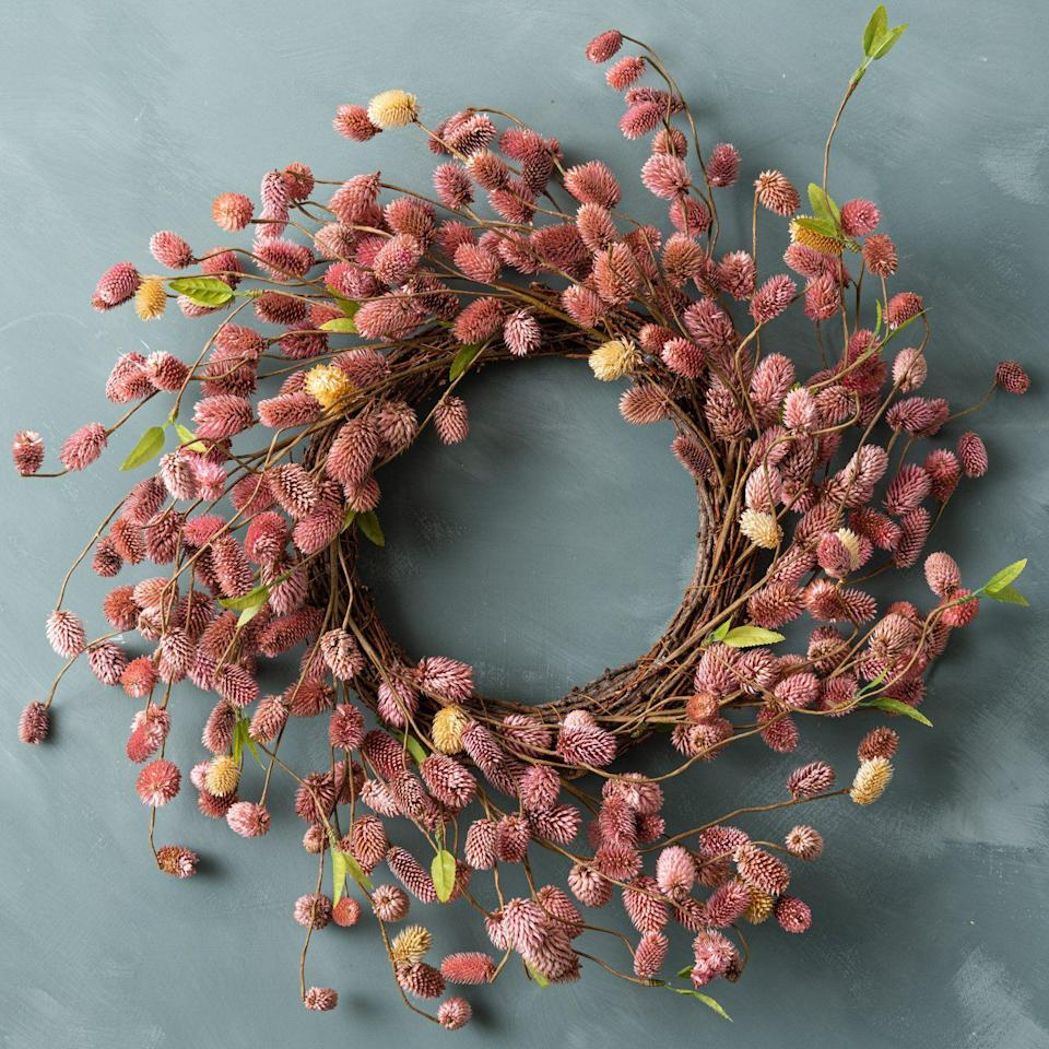 """<p><strong>Magnolia</strong></p><p>magnolia.com</p><p><strong>$74.00</strong></p><p><a href=""""https://shop.magnolia.com/products/dried-natural-platycarya-wreath"""" rel=""""nofollow noopener"""" target=""""_blank"""" data-ylk=""""slk:BUY NOW"""" class=""""link rapid-noclick-resp"""">BUY NOW</a></p><p>For a more romantic wreath that still feels fall-appropriate, opt for this orange rose beauty. The asymmetrical shape spices things up, too. </p>"""
