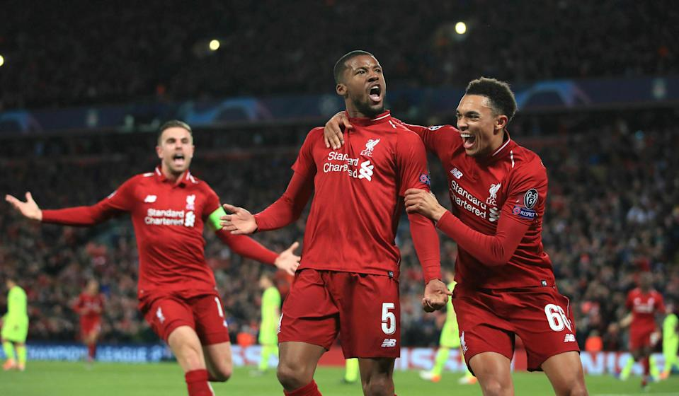 Liverpool's Georginio Wijnaldum, center, celebrates scoring his side's third goal of the game during the Champions League Semi Final, second leg soccer match between Liverpool and Barcelona at Anfield, Liverpool, England, Tuesday, May 7, 2019. (Peter Byrne/PA via AP)