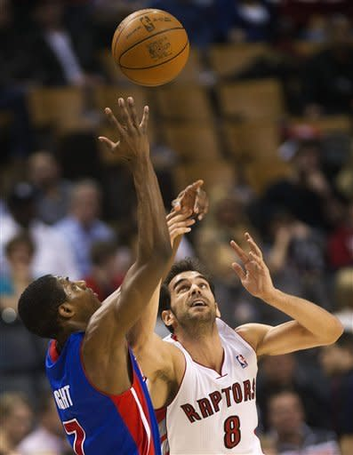 Toronto Raptors guard Jose Calderon, right, and Detroit Pistons guard Brandon Knight, left, battle for the loose ball during first-half NBA basketball game action in Toronto, Wednesday, Feb. 22, 2012. (AP Photo/The Canadian Press, Nathan Denette)
