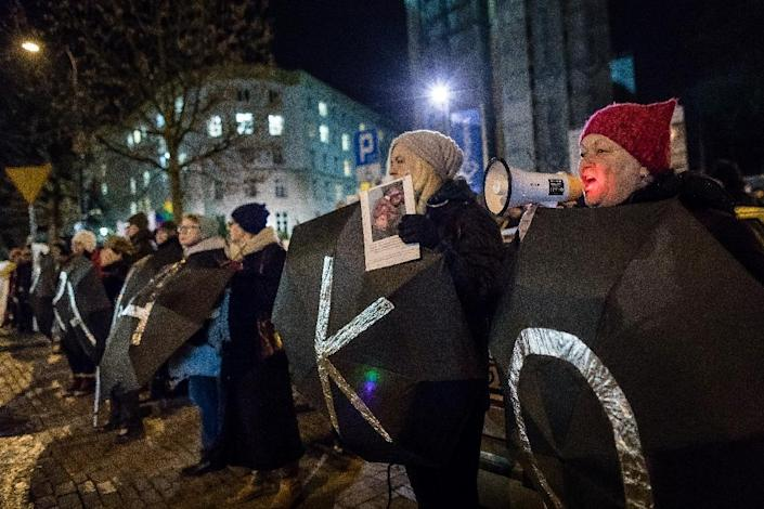 Protesters hold umbrellas bearing letters to read the expression 'Women's Rights' during an anti-government and pro-abortion demonstration in Warsaw (AFP Photo/Wojtek RADWANSKI)
