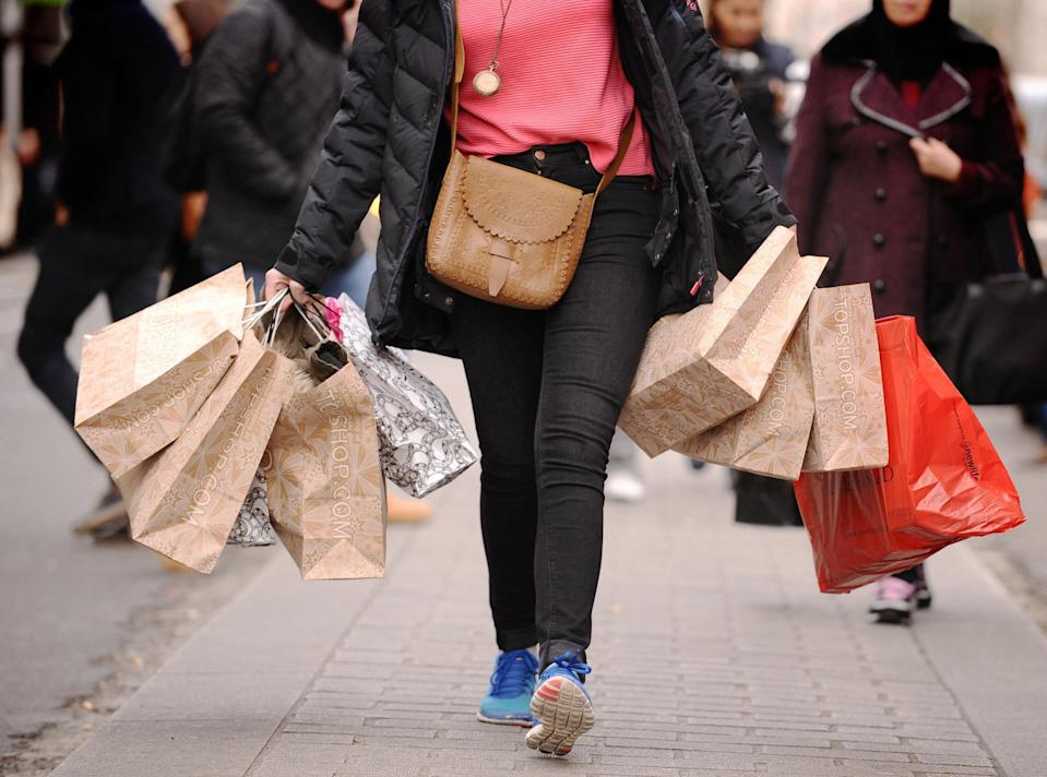 EMBARGOED TO 0001 TUESDAY FEBRUARY 9 File photo dated 05/11/19 of a person carrying shopping. Retail sales slid in January as the latest national lockdown hammered shops across the UK, according to new figures. Issue date: Tuesday February 9, 2021.