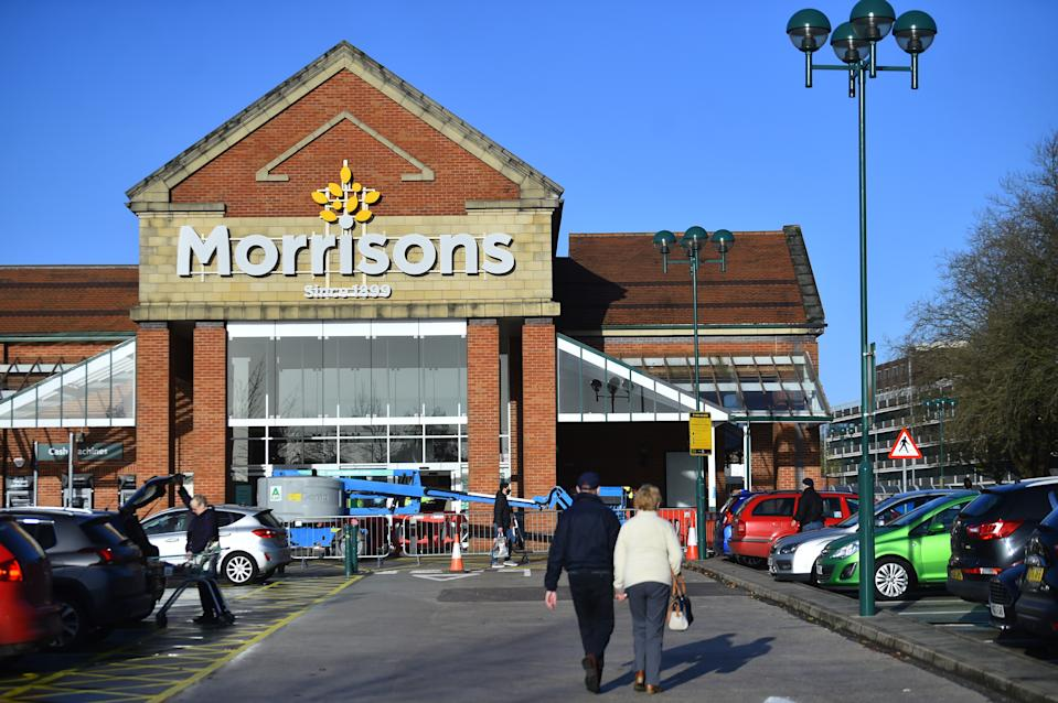 NEWCASTLE-UNDER-LYME- NOVEMBER 13: People are seen shopping at supermarket company, Morrisons on November 13, 2020 in Newcastle-Under-Lyme, Staffordshire . (Photo by Nathan Stirk/Getty Images)