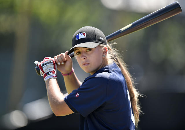 Melissa Mayeux holds the bat as she poses at a baseball camp in Paderborn, Germany, Wednesday, July 1, 2015. The 16-year-old player on the French U-18 junior national team, made history when she became the first woman on Major League Baseball's international registration list, making her eligible to be signed by Major League teams. (AP Photo/Martin Meissner)