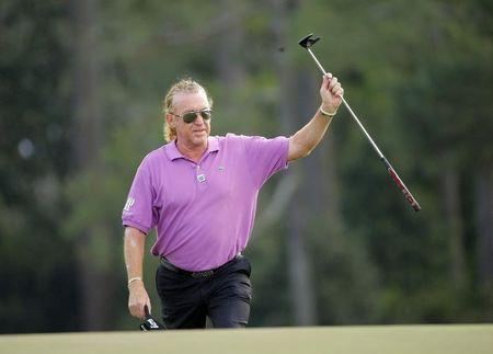Spain's Miguel Angel Jimenez walks to the 18th green during the final round of the Masters golf tournament at the Augusta National Golf Club in Augusta