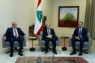 Designated Prime Minister Saad al-Hariri, meets with Lebanon's President Michel Aoun and Lebanese Speaker of the Parliament Nabih Berri at the presidential palace in Baabda