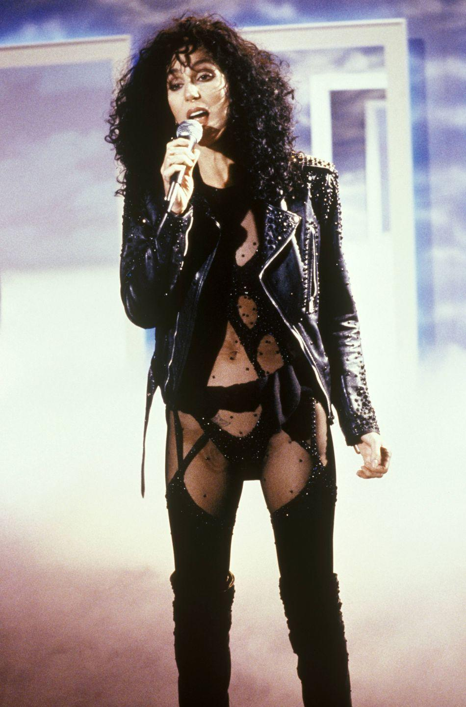 <p>Performing in her iconic cutout bodysuit and leather jacket. </p>