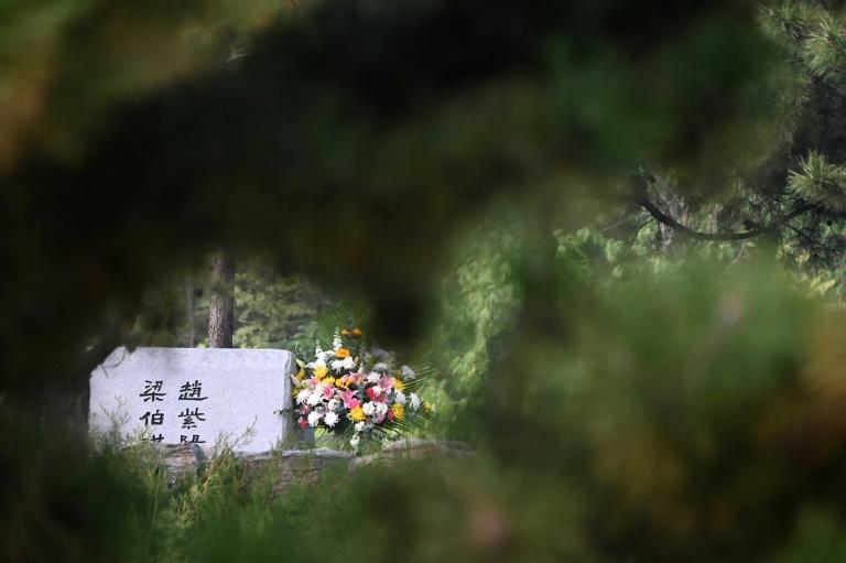 The simple grey headstone of former Chinese Communist Party leader Zhao Ziyang at the Changping cemetery, where a day after his burial three people were seen paying their respects despite heavy security (AFP Photo/NOEL CELIS)