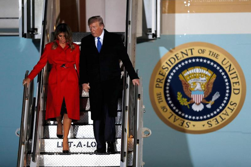 Donald Trump and First Lady Melania Trump disembark Air Force One after landing at Stansted Airport (AFP via Getty Images)