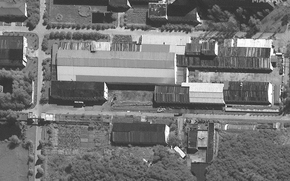 A black and white satellite image shows the facility from above - Maxar Tech/AFP