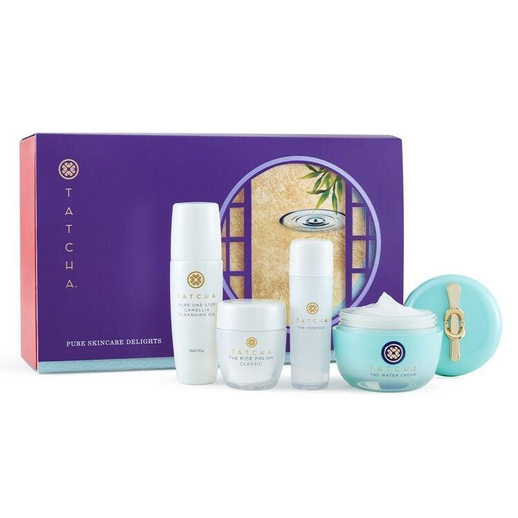 "<h3>Tatcha Pure Skincare Delights</h3> <br> Tatcha's spectacular array of <a href=""https://www.tatcha.com/category/gifts-sets/"" rel=""nofollow noopener"" target=""_blank"" data-ylk=""slk:holiday sets"" class=""link rapid-noclick-resp"">holiday sets</a> has something for every budget, but we're eyeing this four-piece kit featuring a full-size of the fan-favorite <a href=""https://www.refinery29.com/en-us/tatcha-water-cream-moisturizer-review"" rel=""nofollow noopener"" target=""_blank"" data-ylk=""slk:Water Cream"" class=""link rapid-noclick-resp"">Water Cream</a> . <br> <br> <strong>Tatcha</strong> Pure Skincare Delights, $, available at <a href=""https://go.skimresources.com/?id=30283X879131&amp;url=https%3A%2F%2Fwww.tatcha.com%2Fproduct%2FSB10042T.html"" rel=""nofollow noopener"" target=""_blank"" data-ylk=""slk:Tatcha"" class=""link rapid-noclick-resp"">Tatcha</a>"
