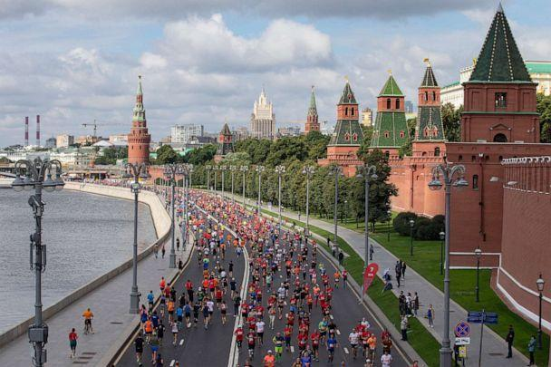 PHOTO: People run past the Kremlin Wall as they take part in a half-marathon in Moscow, Aug., 2, 2020. (Alexander Zemlianichenko Jr/AP)