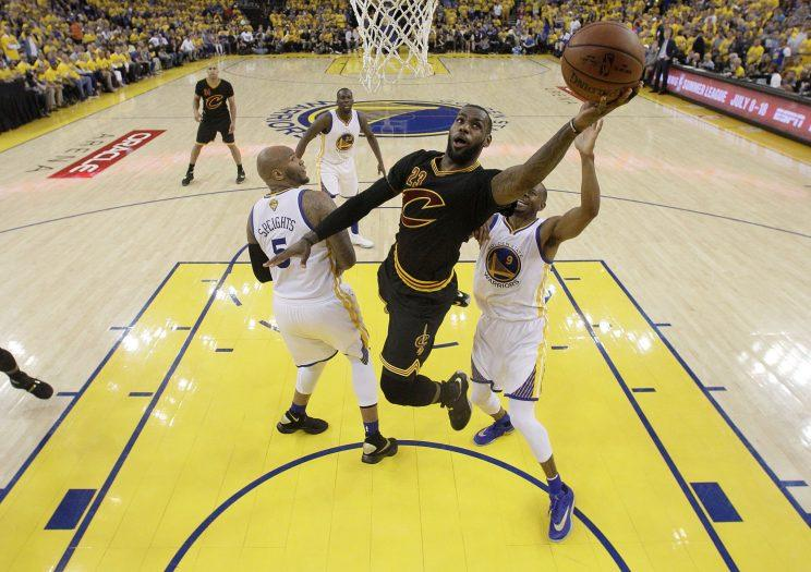 3806af091ca LeBron James drives to the basket in a very special shoe during the 2016 NBA  Finals