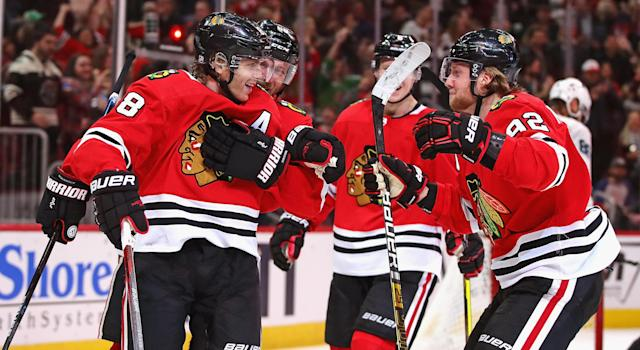 With it being announced that NHL players will be paid for the rest of the reason, Patrick Kane and many others have plenty of reason to celebrate. (Photo by Jonathan Daniel/Getty Images)