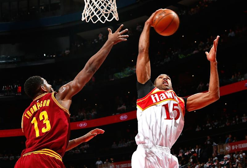 Al Horford of the Atlanta Hawks grabs a rebound against Tristan Thompson of the Cleveland Cavaliers at Philips Arena on March 6, 2015 in Atlanta, Georgia