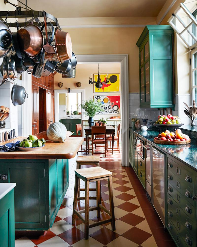 Vintage stools from obsolete belly up to the kitchen island.