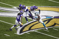 Carolina Panthers wide receiver Curtis Samuel (10) catches a pass over Minnesota Vikings strong safety Harrison Smith (22) on the Panthers last drive of an NFL football game in Minneapolis, Sunday, Nov. 29, 2020. (Jerry Holtz/Star Tribune via AP)