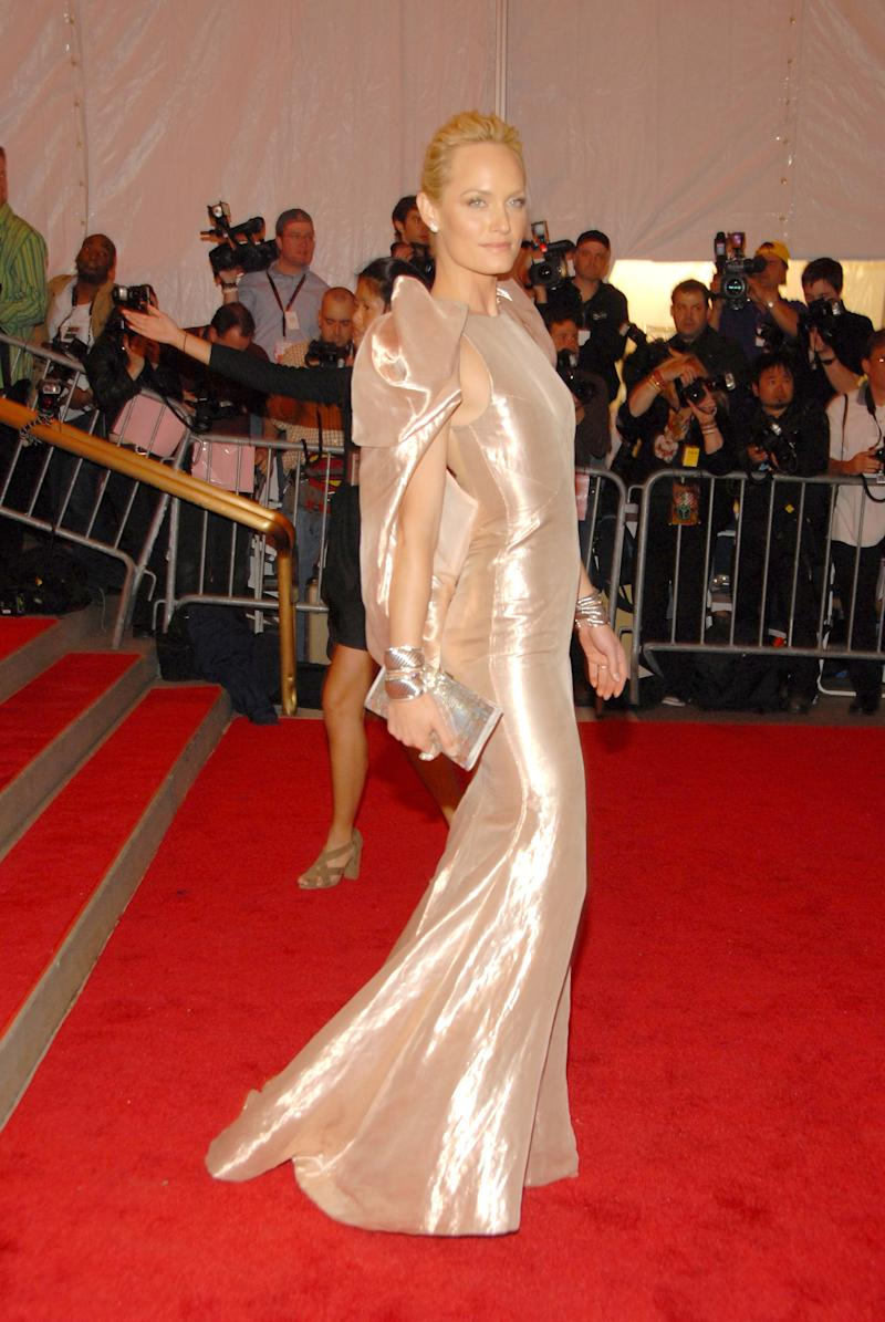 """Amber Valletta wearing Atelier Versace attends the Metropolitan Museum of Art Costume Institute Gala """"Superheroes: Fashion And Fantasy"""" at the Metropolitan Museum of Art on May 5, 2008 in New York City."""