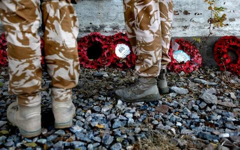 British soldiers attend a Remembrance Day ceremony at the British cemetery in Kabul in 2009 - Credit: Reuters