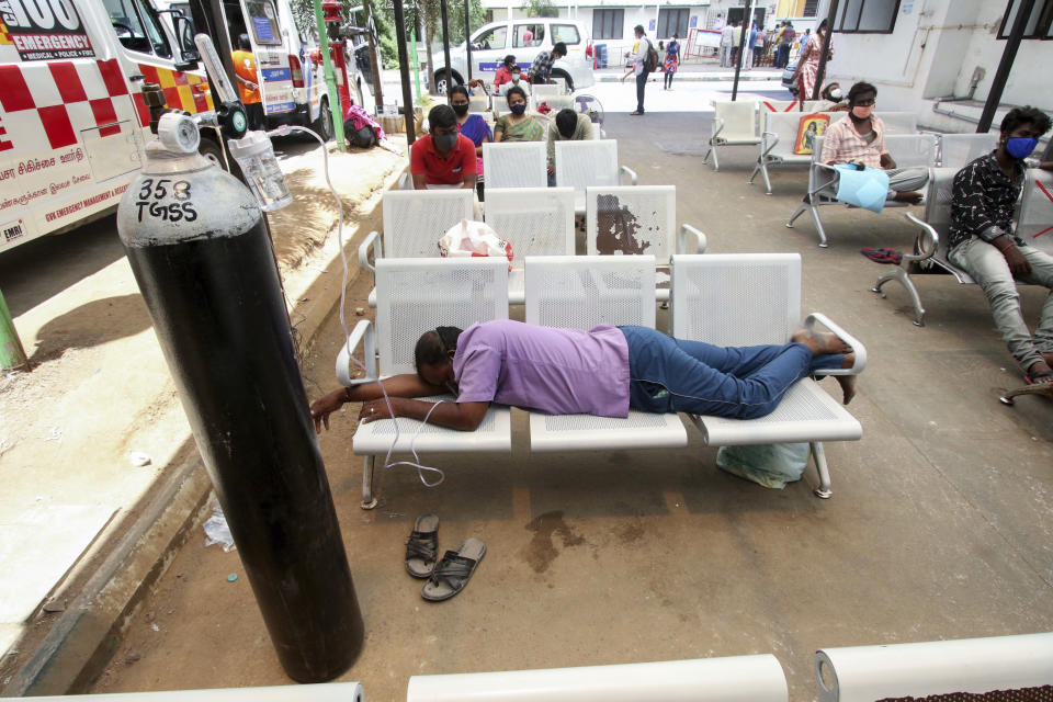 A COVID-19 patient on oxygen support waiting for admission lies on chairs outside the Tamil Nadu Government Multi Super Speciality Hospital in Chennai, India, Monday, May 17, 2021. Source:  Associated Press