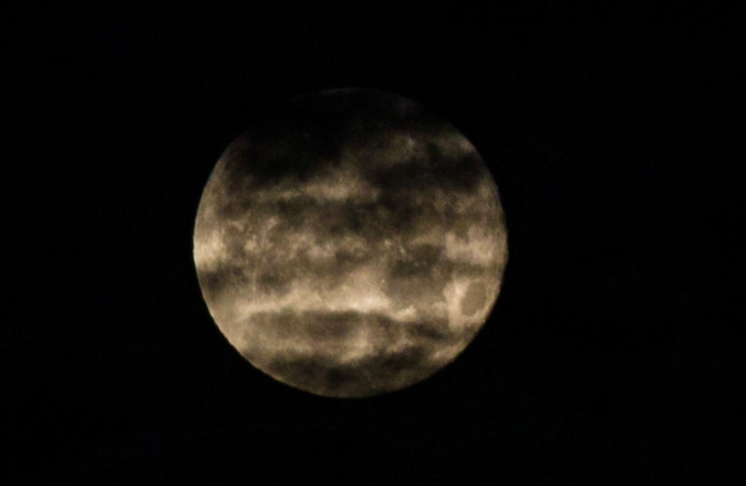 <p>Clouds drift over the Supermoon above the skies of North London. (Rex) </p>