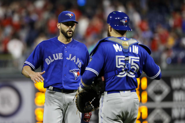 Toronto Blue Jays relief pitcher Ryan Tepera, left, and catcher Russell Martin celebrate after a baseball game against the Philadelphia Phillies, Friday, May 25, 2018, in Philadelphia. (AP Photo/Matt Slocum)
