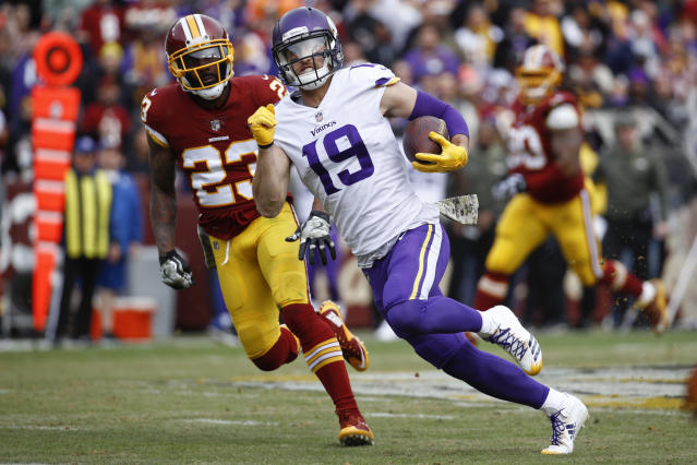 Receiver Adam Thielen (R) is one of the reasons the Vikings have been one of the NFL's best stories this season. (AP)