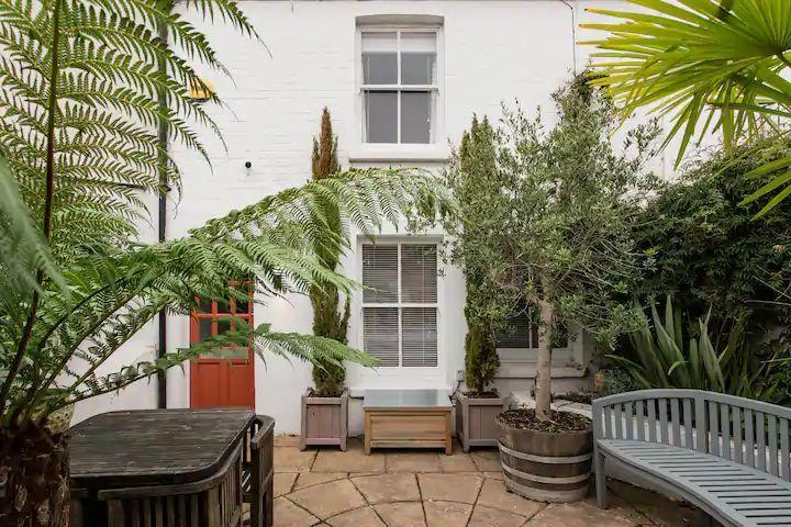 """<p>A tranquil retreat for a family or a few friends, this Airbnb in Brighton is a haven in the city. The peaceful house in North Laine features unique artwork, original architectural finishes and monochrome decor with wood accents and subtle touches of colour. We like!</p><p><strong>Sleeps: </strong>Five</p><p><strong>Price per night: </strong>£150.00</p><p><strong>Why we like it: </strong>The stylish mix of mid-century and antique furniture</p><p><a class=""""link rapid-noclick-resp"""" href=""""https://airbnb.pvxt.net/ZddMPk"""" rel=""""nofollow noopener"""" target=""""_blank"""" data-ylk=""""slk:SEE INSIDE"""">SEE INSIDE</a></p>"""
