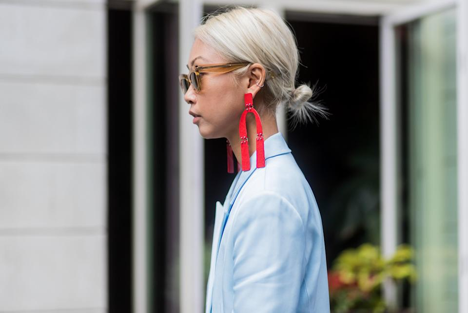 Sweep your hair into a sleek bun at the nape of your neck to really show off a pair of statement earrings.