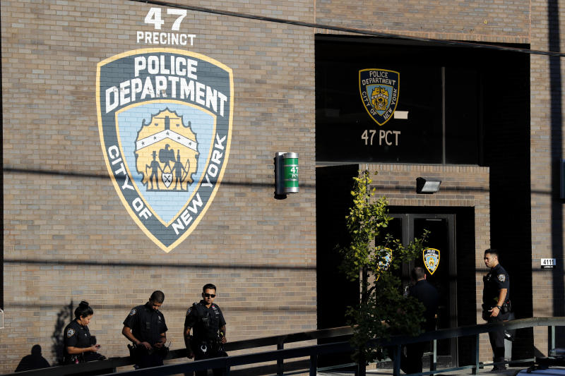 Police officers stand in front of the 47th precinct, near the scene of a fatal shooting of a New York City police officer in the Bronx borough of New York, Sunday, Sept. 29, 2019.  (AP Photo/Seth Wenig)