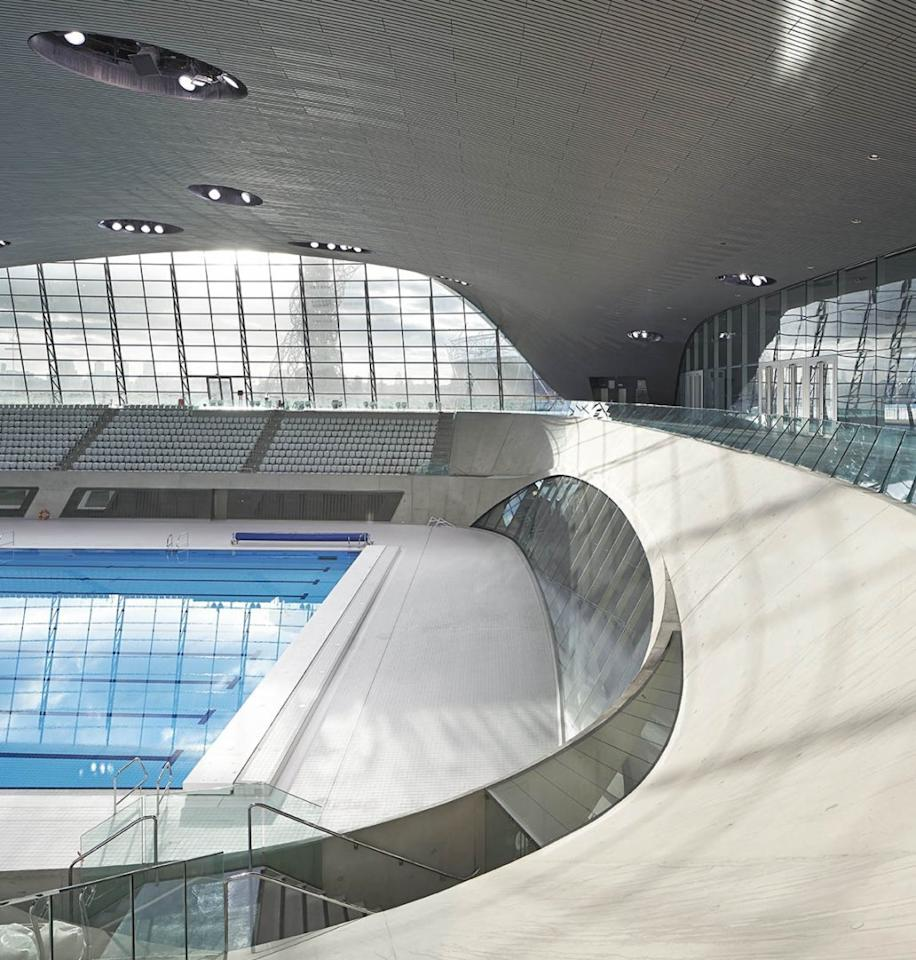 "<p>Hadid's <a href=""http://www.londonaquaticscentre.org"">stadium</a> for the 2012 Olympics was inspired by the swimming pools housed inside, with a roof that undulates like the surface of water. <i>Photo: Hufton+Crow</i></p>"