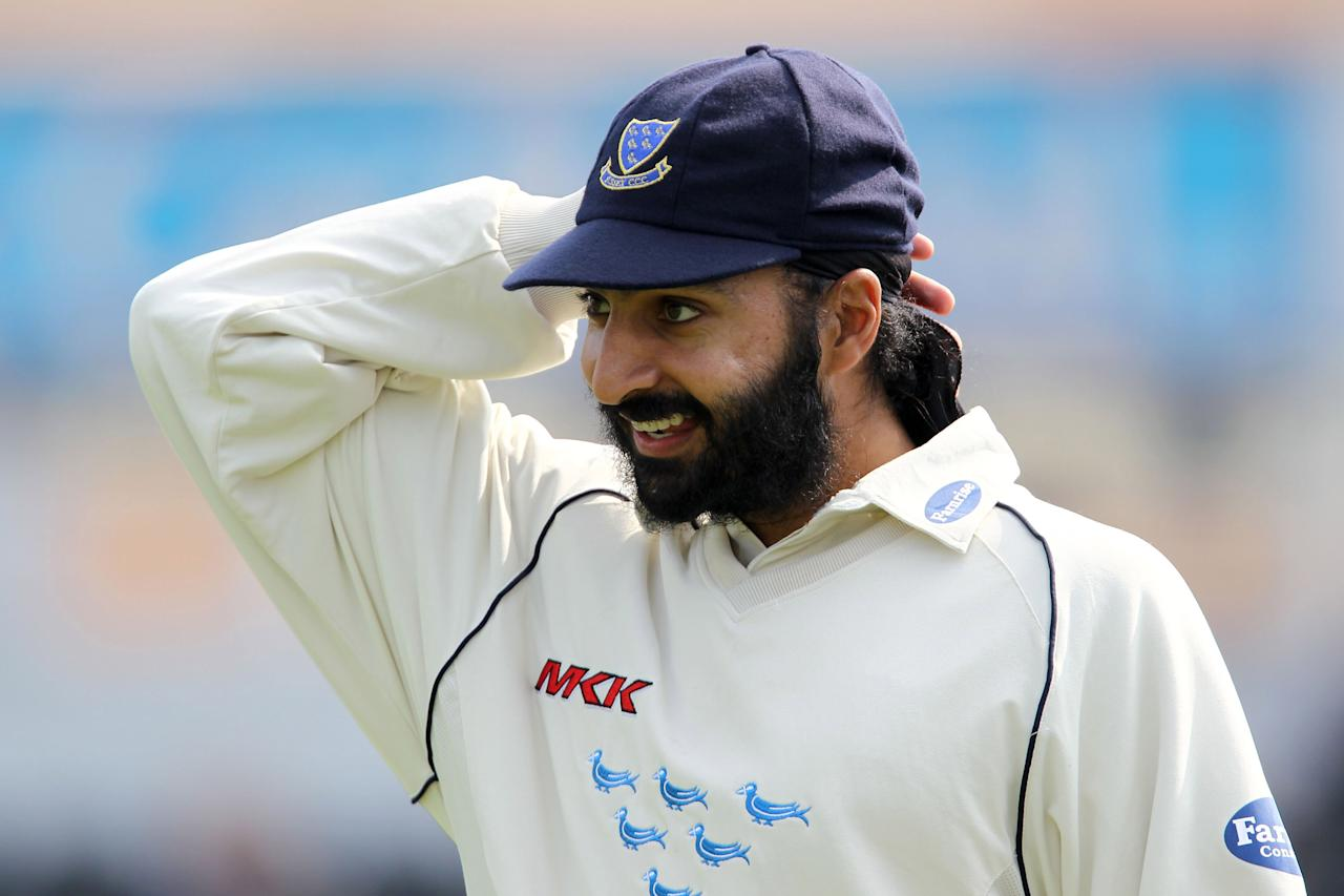 HOVE, ENGLAND - APRIL 15:  Monty Panesar of Sussex looks on in the field during the LV County Championship Division Two match between Sussex and Surrey at the County Ground on April 15, 2010 in Hove, England.  (Photo by Clive Rose/Getty Images)