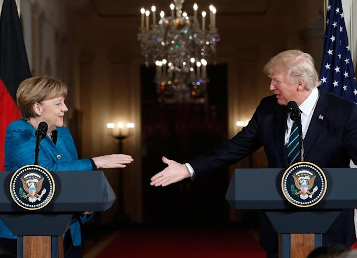 <p>President Donald Trump and German Chancellor Angela Merkel reach to shakes hands after their joint news conference in the East Room of the White House in Washington, Friday, March 17, 2017. (Photo: Pablo Martinez Monsivais/AP) </p>