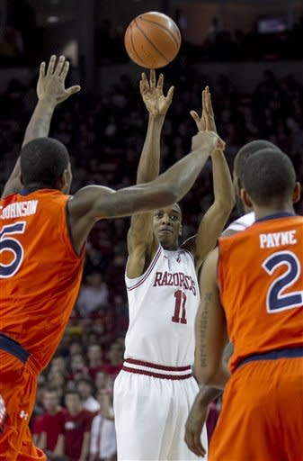 Arkansas' BJ Young (11) shoots against Auburn's Shaquille Johnson (5) during the first half an NCAA college basketball game in Fayetteville, Ark., Wednesday, Jan. 16, 2013. (AP Photo/Gareth Patterson)