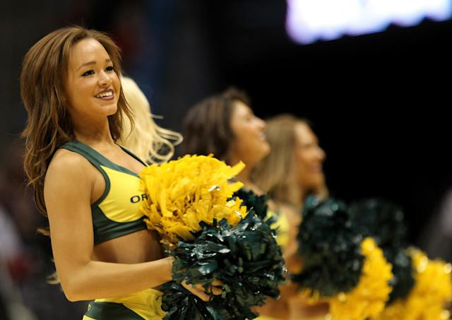 MILWAUKEE, WI - MARCH 20: Oregon Ducks cheerleaders perform during the second round game of the NCAA Basketball Tournament against the Brigham Young Cougars at BMO Harris Bradley Center on March 20, 2014 in Milwaukee, Wisconsin. (Photo by Mike McGinnis/Getty Images)